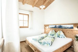 cosy bedroom on the farm with solid furniture