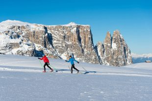 Cross-country skiing over the Seiser Alm with the Schlern in the background